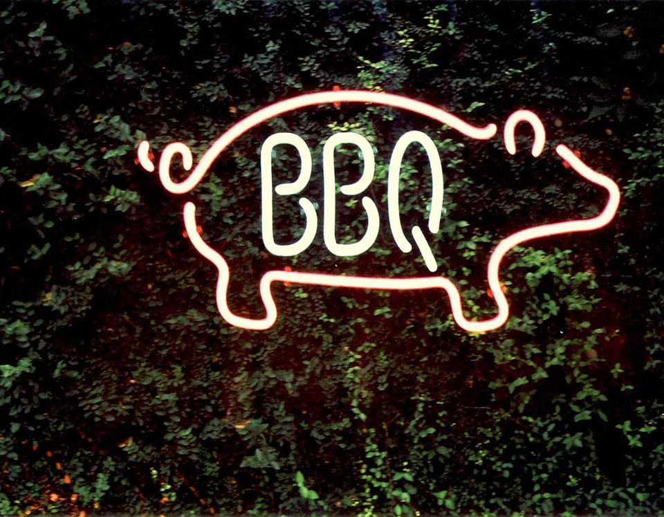 Neon tube signs are produced by the craft of bending glass tubing into shapes.